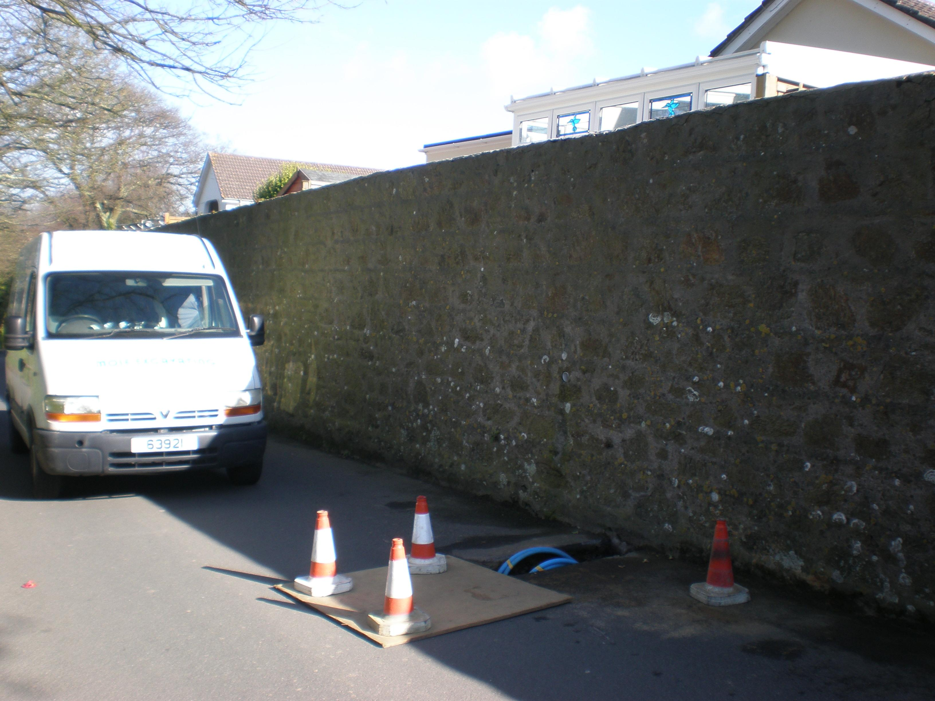 Guernsey Mole Excavating under a wall